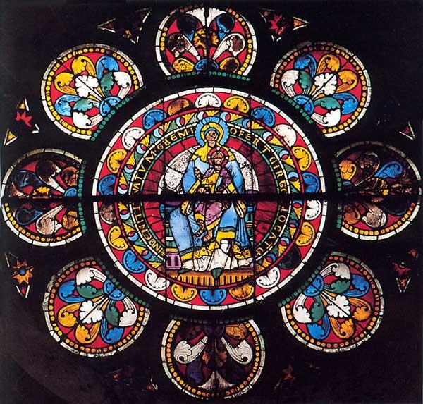 Rose du transept nord de l'abbatiale de Wissembourg représentant la Madone en gloire. Le panneau central date de 1190, la couronne de motifs du XIIIè