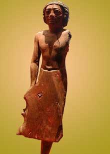Statuette d'homme. Bois de jujubier. Fin Vè – début VIè dynasties. Musée du Louvre (Histoire de l'Egypte ancienne)