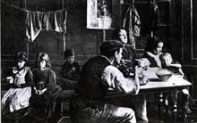 Londres, East End, début du XXè siècle: un intérieur ouvrier pauvre