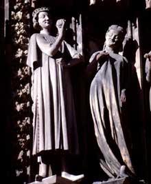 Strasbourg, cathédrale: détail du portail de droite de la façade occidentale, dit «portail des Vierges sages et des vierges folles»: le tentateur et une vierge folle