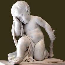 Jean Baptiste Defernex (1729-1783): génie affligé. Marbre blanc, 53cm. Ce génie est un fragment du monument funéraire de Germain Anne Loppin de Montmort (1708-1767), président à Mortier du parlement de des Etats de Bourgogne. Paris, musée du Louvre