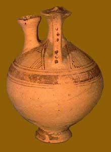 Vase à étrier de type crétois d'époque protogéométrique. Hauteur, 14,5cm. IXè avant JC. Oxford, Ashmolean Museum. (Art grec)