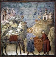 Giotto : Légende de saint François: François donne son manteau à un pauvre. 1297-1299. Fresque, 270 x 230 cm. Assise, église supérieure Saint François