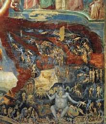 Giotto : Le Jugement dernier, détail. 1306. Fresque. Padoue: la chapelle Scrovegni ou chapelle de l'Arena. Le Prince de l'Enfer, un monstre géant, trône sur un dragon dévorant. Il attrappe les damnés et les engloutit. Les tourments du peuple nu, attaqué par les créatures infernales, sont dépeints de manière très détaillée